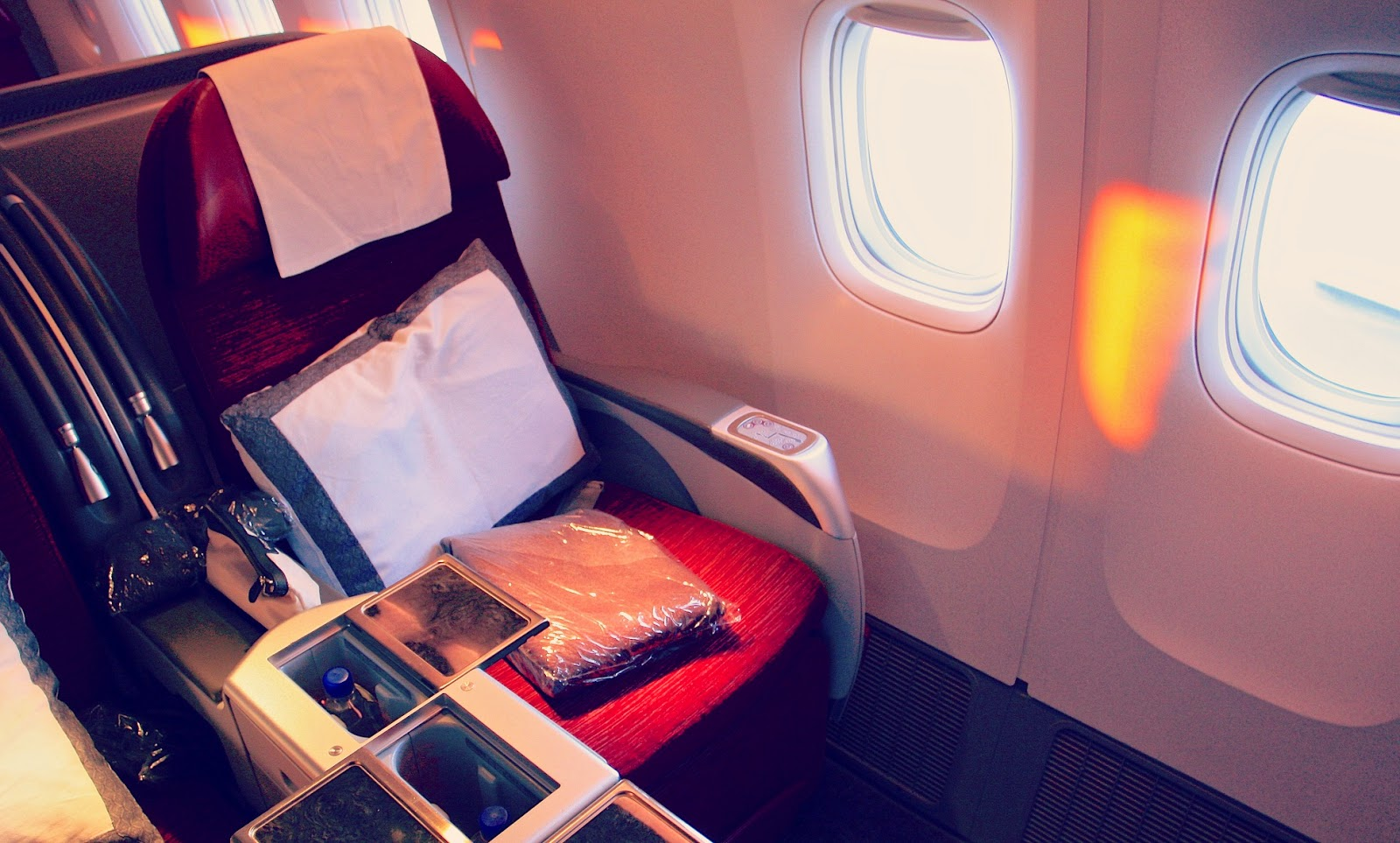 My private writing atelier at 36,000 feet with a window as a muse