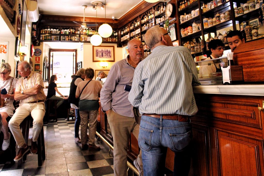Men drinking at a bar in Madrid