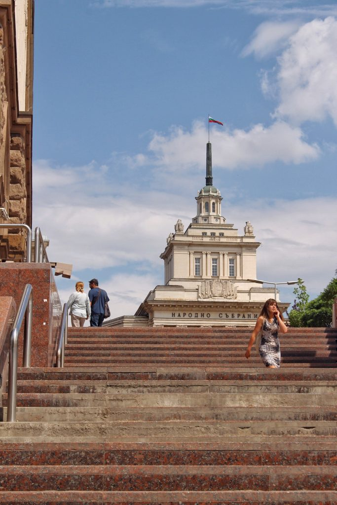 a woman walking down the stairs