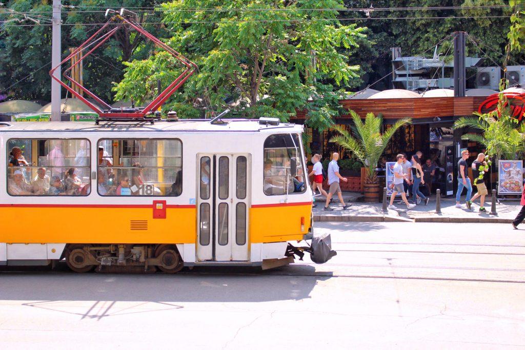 yellow tram passing